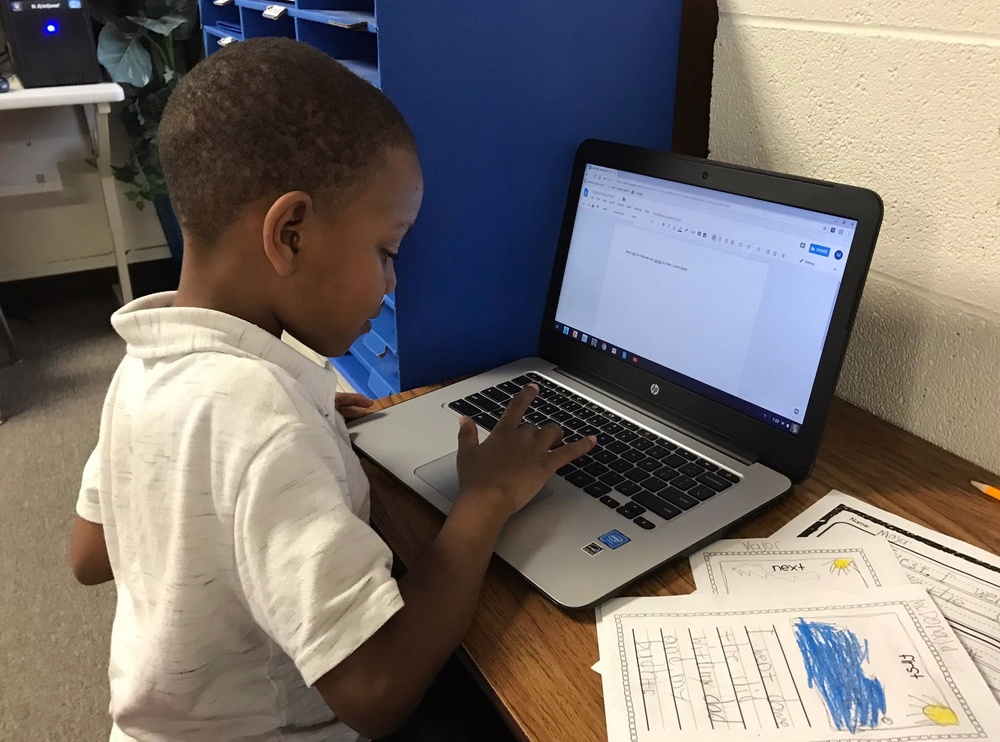 Major McDonald works on a Chromebook to publish his first personal narrative!