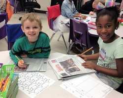Mrs. Hammett's second graders using the newspaper for Phonics!